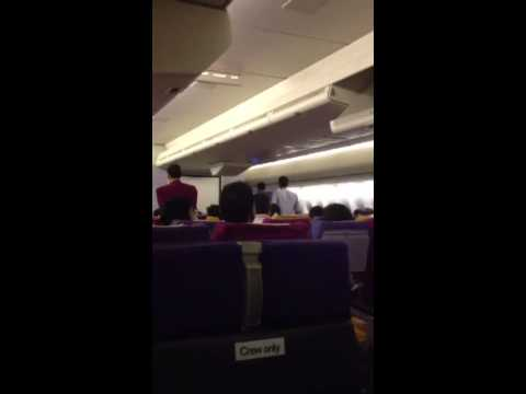 Thai Airways TG 318. Police escorting drunk Indian guy off the plane after groping a flight atten...