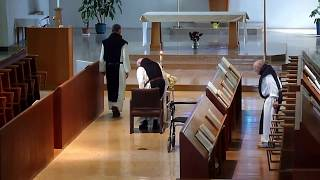 Fr. Joseph pre funeral prayers with Br. B praying for Fr. J the day before his burial