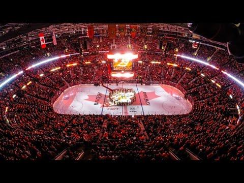 "Ottawa Montreal and Toronto sing ""O Canada"""
