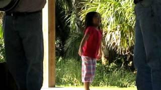 Little girl dancing to Blue Grass music