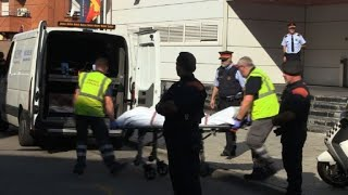Body of Spain knifeman removed from police station