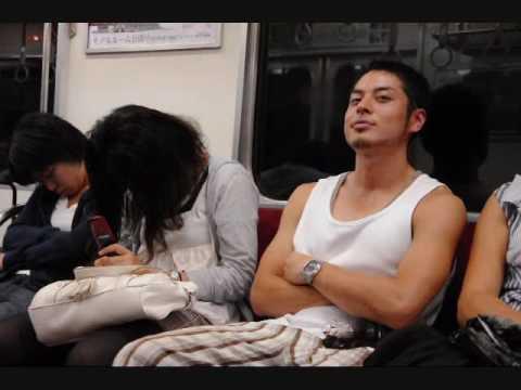 Japanese woman sleeping on a train.