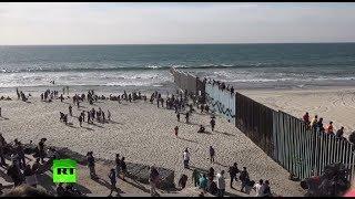 Dozens of migrants climb border fence near Tijuana, Mexico