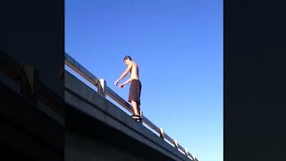 crazy guy does backflip off building..