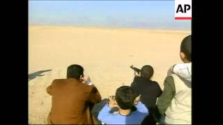 Video of Qusay teaching son to shoot