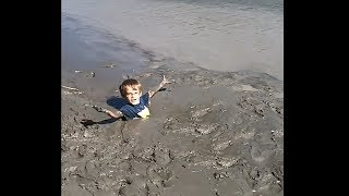 kid gets trapped in deep quicksand... (SCARY)