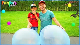 Playing with Bubble Wubble Inflatable Ball for Kids with Jason
