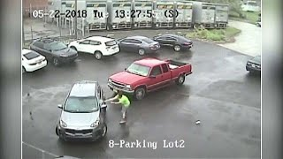Driver caught on camera attacking another vehicle and passenger with a sledgehammer