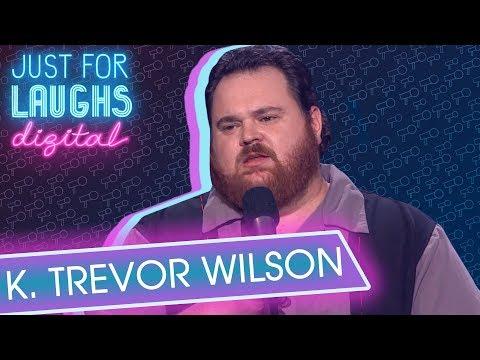 K. Trevor Wilson Bearded Man Blowing Road Sign