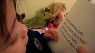 Maddox Reading another Backyardigans mini book