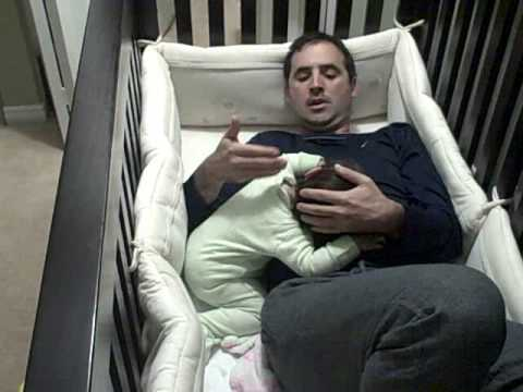 Father goes into baby crib!
