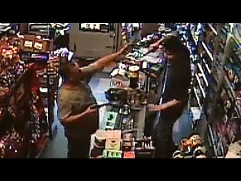 Armed robber meets his match CCTV
