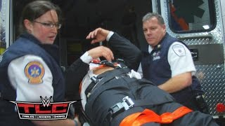 Triple H is loaded into an ambulance after being attacked by Roman Reigns: December 13, 2015