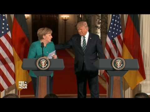 First Trump Merkel meeting reflects different views styles