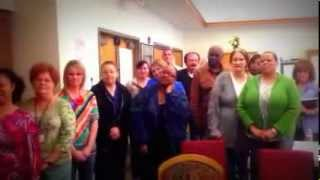 Team members at William R. Courtney Reciting Touchstone's Purpose & Mission