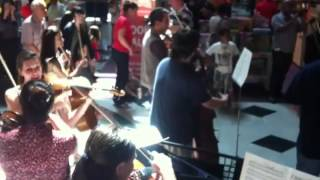 Cape Philharmonic Orchestra flash mob at Canal Walk shopping centre in Cape Town, South Africa