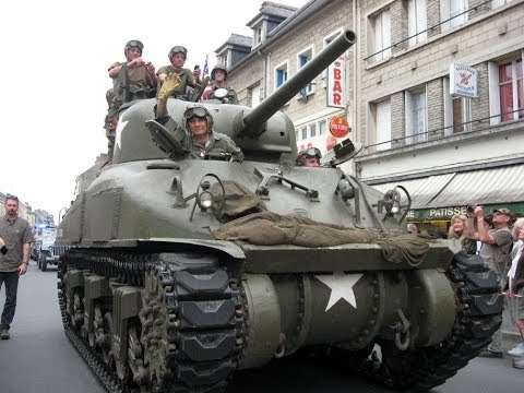 watch WWII U.S. Army Vehicles Parade, Goldwing ride in Normandy (pt3)