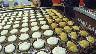 Netherlands Street Food. Fast Preparation of Sweet Pancakes Poffertjes