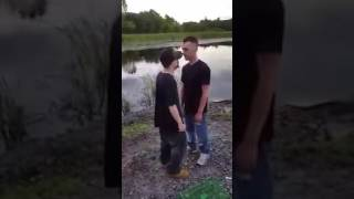 Funny video of two drunk guys fighting next to a lake