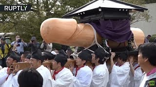Rub it for luck: Giant wooden penis celebrated at Japanese fertility festival