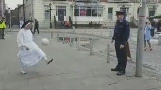 Nun shows off crazy football skills playing keepy uppy with policeman
