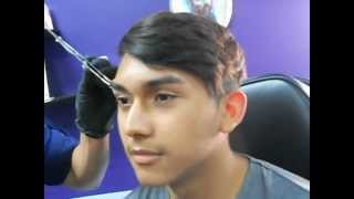My Cousin getting an eyebrow piercing