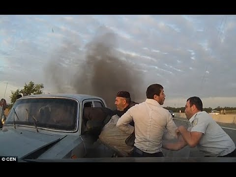 Dramatic moment: Drivers battle to save car crash victims from burning alive a fireball