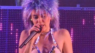 Miley Cyrus performs TOPLESS while wearing a strap on penis – her most shocking look yet?