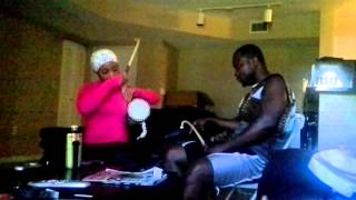Tunde n charles. How to play talking drum