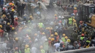 Crews race to save trapped schoolgirl from earthquake rubble