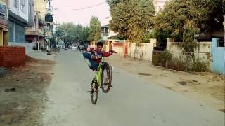 Small boy trying to do cycle stunts