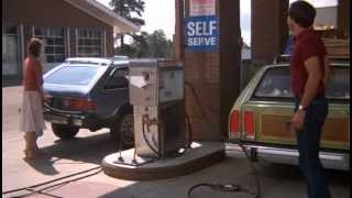 National Lampoon's Vacation - Clark fixing the license plate at a gas station