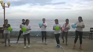 P E  dance exercise using beachball