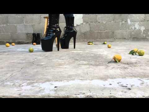 Boy crushing lemons & walking in platform high heels Big heels vs Little heels