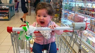 Cute Baby Sitting For The First Time In a Shopping Cart - Hilarious Reaction