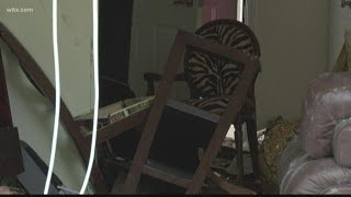 Woman narrowly escapes after car crashes into her apartment