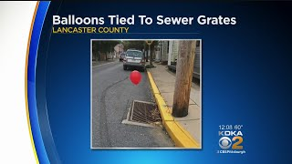 Teen Takes Credit For Red 'It' Balloons Tied To Sewer Grates