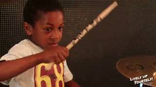 7 year old highly talented drummer jams with reggae band!