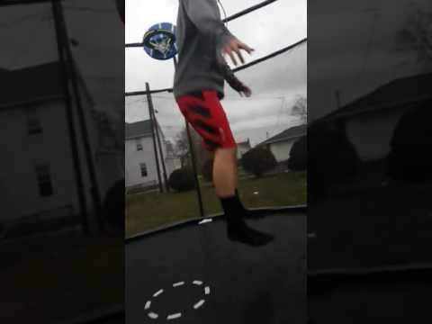 Kid gets erect from back flip