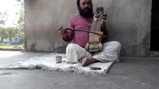 Yogi Sardar Shah playing Sarangi