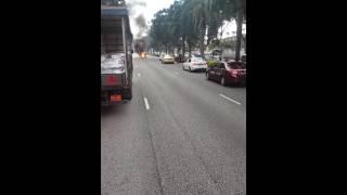 Motor cyxle on fire along AYE