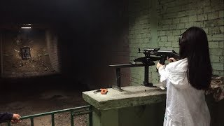 Shooting AK-47 by Chinese cute girl vs father