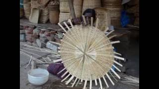 Bamboo Basket Weaving - The expanded base is mended to go vertical