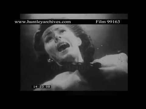 Men Fight as a Woman is Tied to a Guillotine.  Archive film 99163