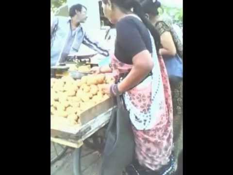 Aunty Stealing Mangoes from a Street Vendor's Cart - Smart Move Aunty