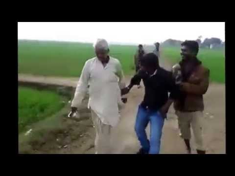Funny video 2015 Man going for toilet in an open field Part I, India
