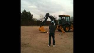 Backhoe picking up an egg in a spoon_Fred.MOV