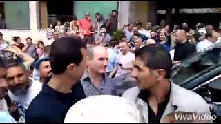 President al Assad among his people in the village of Ain al Kabeer in the Sheikh Badr district in t