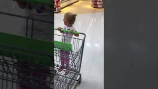 Mia figured out what shopping carts are really for