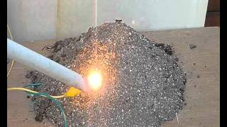 Burning an apple with high voltage and melting sand to glass